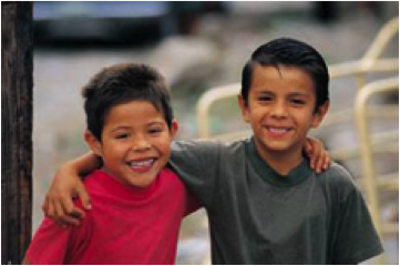 Photo of two young boys smiling